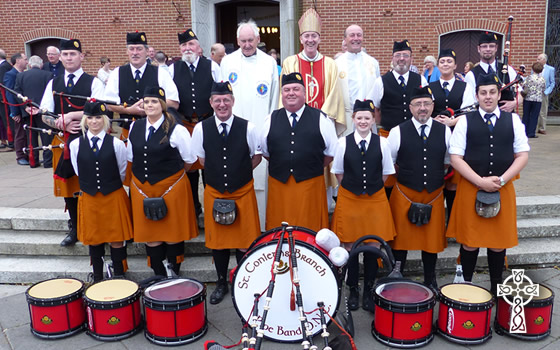 St Conleth's Pipe Band pictured with Bishop Nulty, Msgr John McDonald & Msgr Eoin Thynne HCF